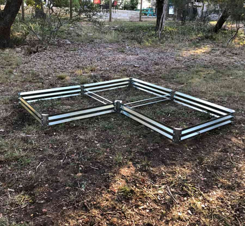 low l-shaped metal garden beds